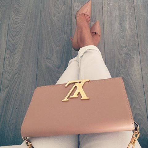 200f229d76f Chic Louis Vuitton cross-body paired with classic Christian ...