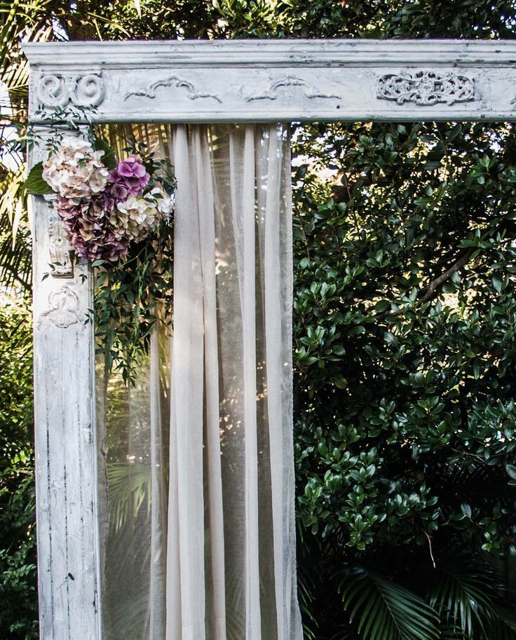 Detailed vintage wooden wedding arch arbor in distressed