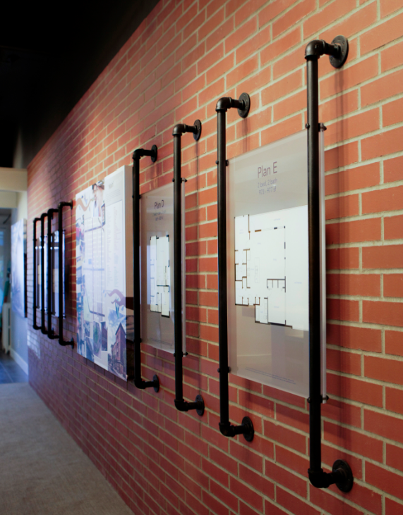 custom pipes used to hold floor plans on brick wall www themill ca