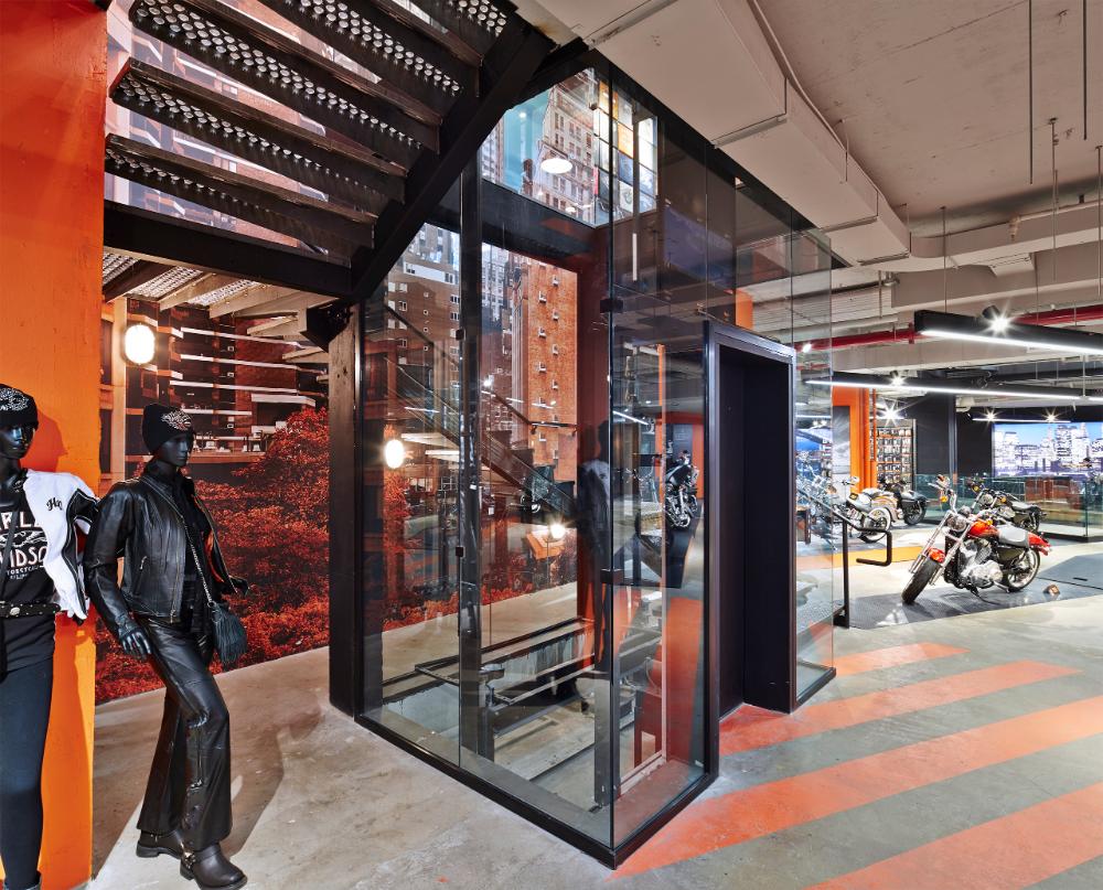 Showroom stairs and elevator #retailstore #harleydavidson #bikeshowroom #brandexperience #motorcycleshowroom #productinteraction #motorcycles #motorcycle #NYC #Manhattan #harleyforlife #usa #freedommachine #findyourfreedom #interactivedigitalwall #glasselevator #elevator #graphics