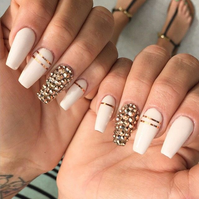 Love these coffin shaped, off white nails with gold stones on the accent  nails - I Like The Idea Of White With Gold Striping Tape Nail Designs