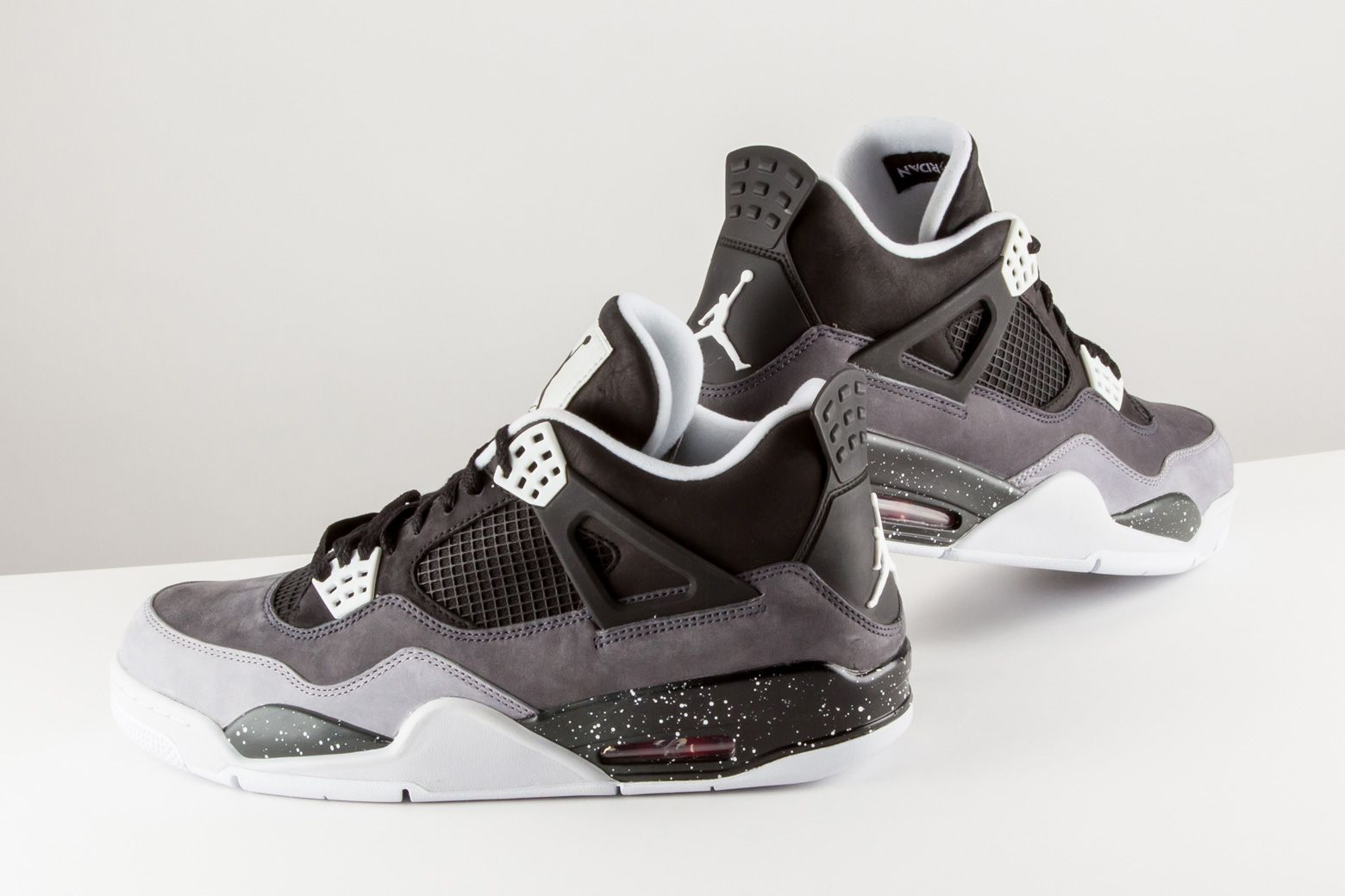 46dbebca6c8 Grey and black suede are a stunning combination on this Air Jordan 4 Retro  from 2013's