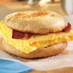 Spicy Bacon and Cheese Eggwich - A new twist on the greasy breakfast sandwich, this complete grab-and-go breakfast features a high-protein egg substitute, tasty turkey bacon and cheddar cheese sandwiched together in a whole wheat English muffin. It serves up 12 grams of protein.