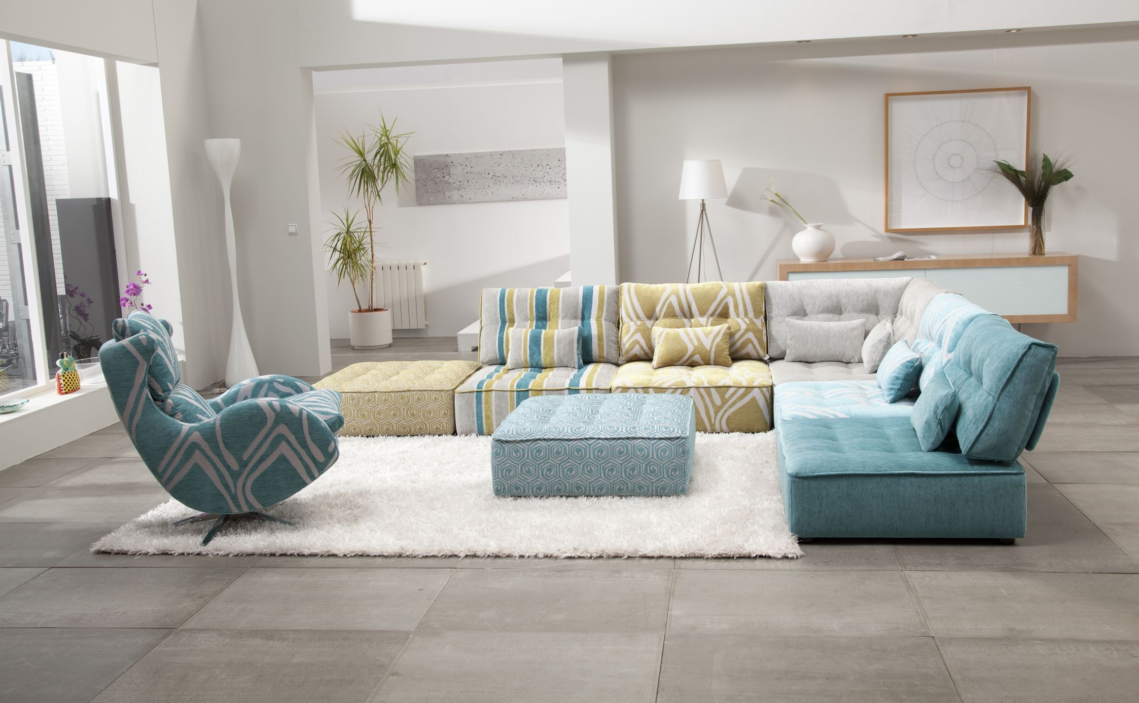 Living Room:Sectional Sofas And Various Colors Printed Sofas And Square  Blue Pattern Pouffe And