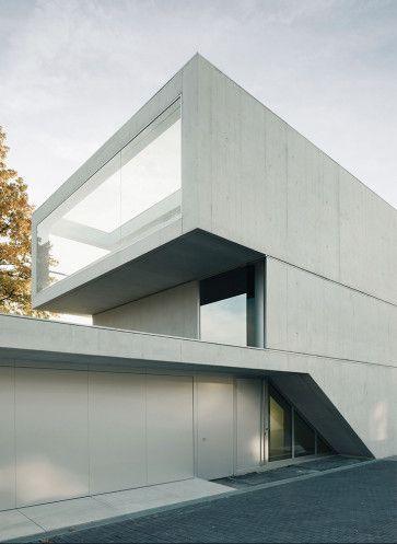 Graue eminenz rascacielos architektur betonfassade for Modernes haus zurich