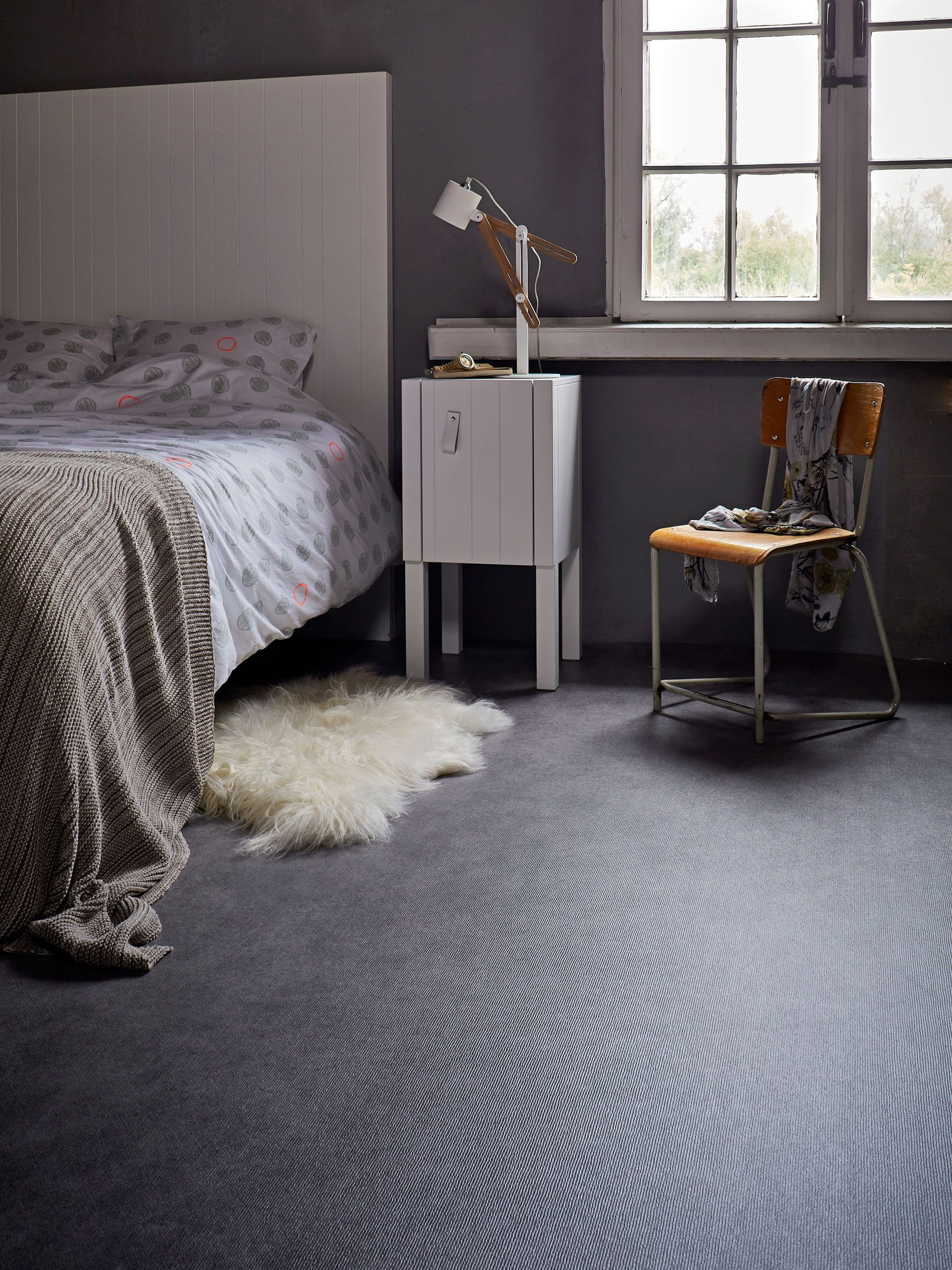 Dark Marmoleum Floor In The Bedroom With A White Bed And Nightstand On Ground There Is Sheepskin Carpet Photographer Alexander Van Berge