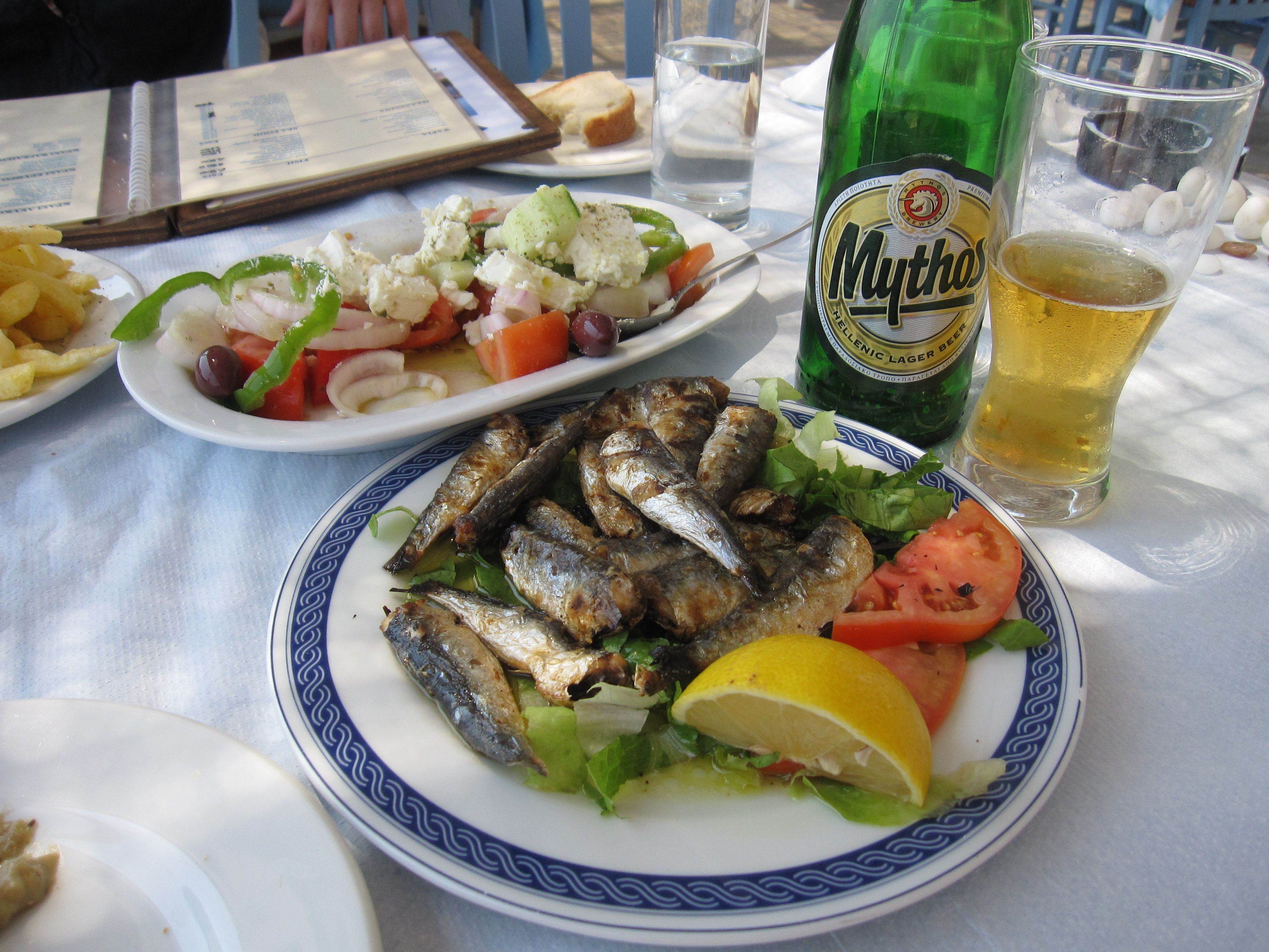 Milos, Greece fresh fried sardines + greek salad + mythos greek beer ...