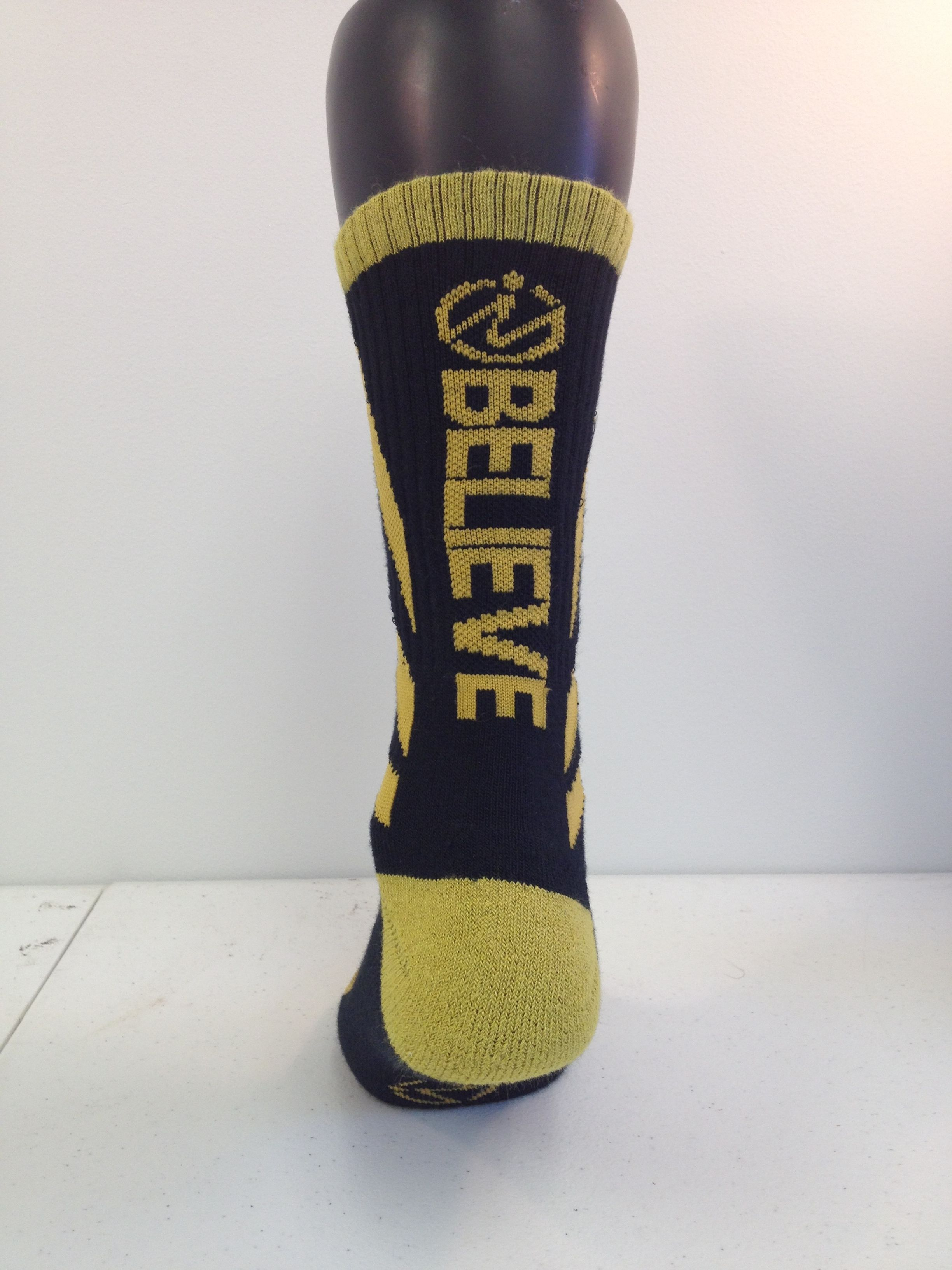 """Believe"" socks from inspyr sock co. These socks were made for childhood cancer month, Sept. Black and Gold represent the awareness colors"