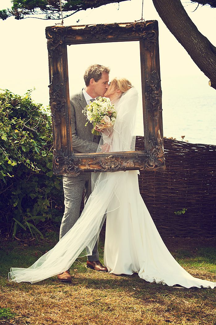 Bride-and-groom-kissing-Polhawn-wedding - picture frame DIY