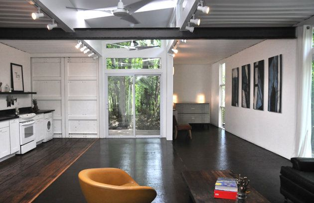 Two shipping containers. The main living area, looking toward the front entry. The kitchen is to the left.