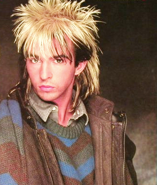 Limahl wins the contest. He represents 80's hairdo!!!