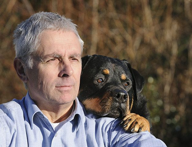 Rottweiler on man's shoulder, by Amanda Hawes    This is the first photography competition Amanda has entered. She took an online photography course and snapped this photo of her husband with their pet dog Klara, a pedigree rottweiler. Amanda says, 'I'm absolutely gobsmacked that I won!'