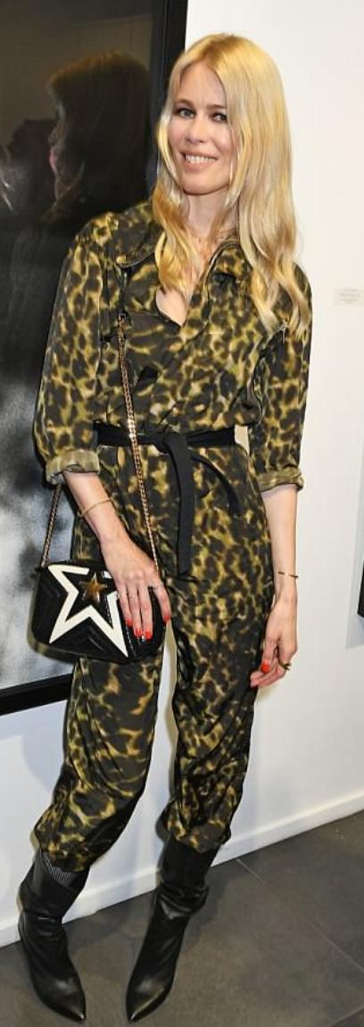 Who Made Claudia Schiffer S Leopard Jumpsuit And Black Star Print Handbag Leopard Jumpsuit Fashion Black Star