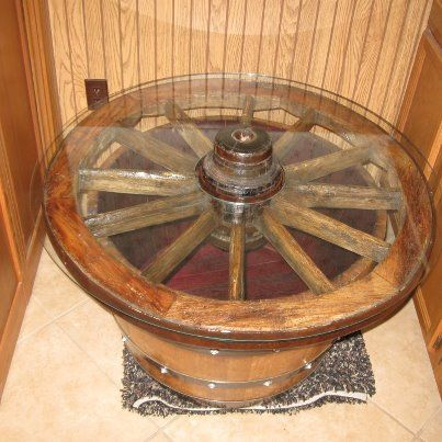 wagon wheel / wine barrel glass top coffee table. | wine barrel