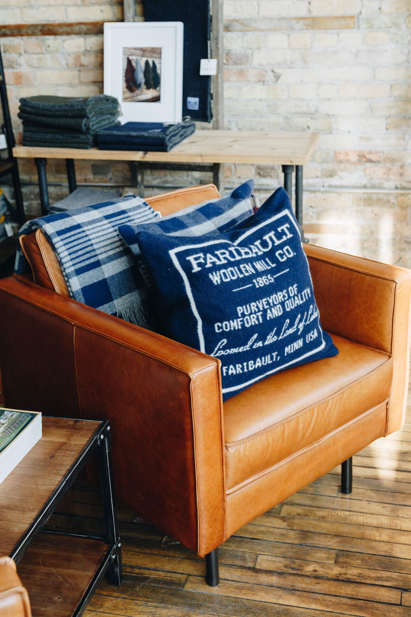 Pictured in Chair Faribault Plaid Throw in Navy