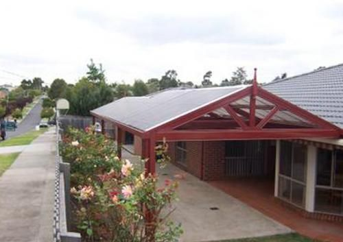 Firmlok Colorbond Frame Gabled Roof Attached Carport With Timber Finial Facade House Carport Building A Deck