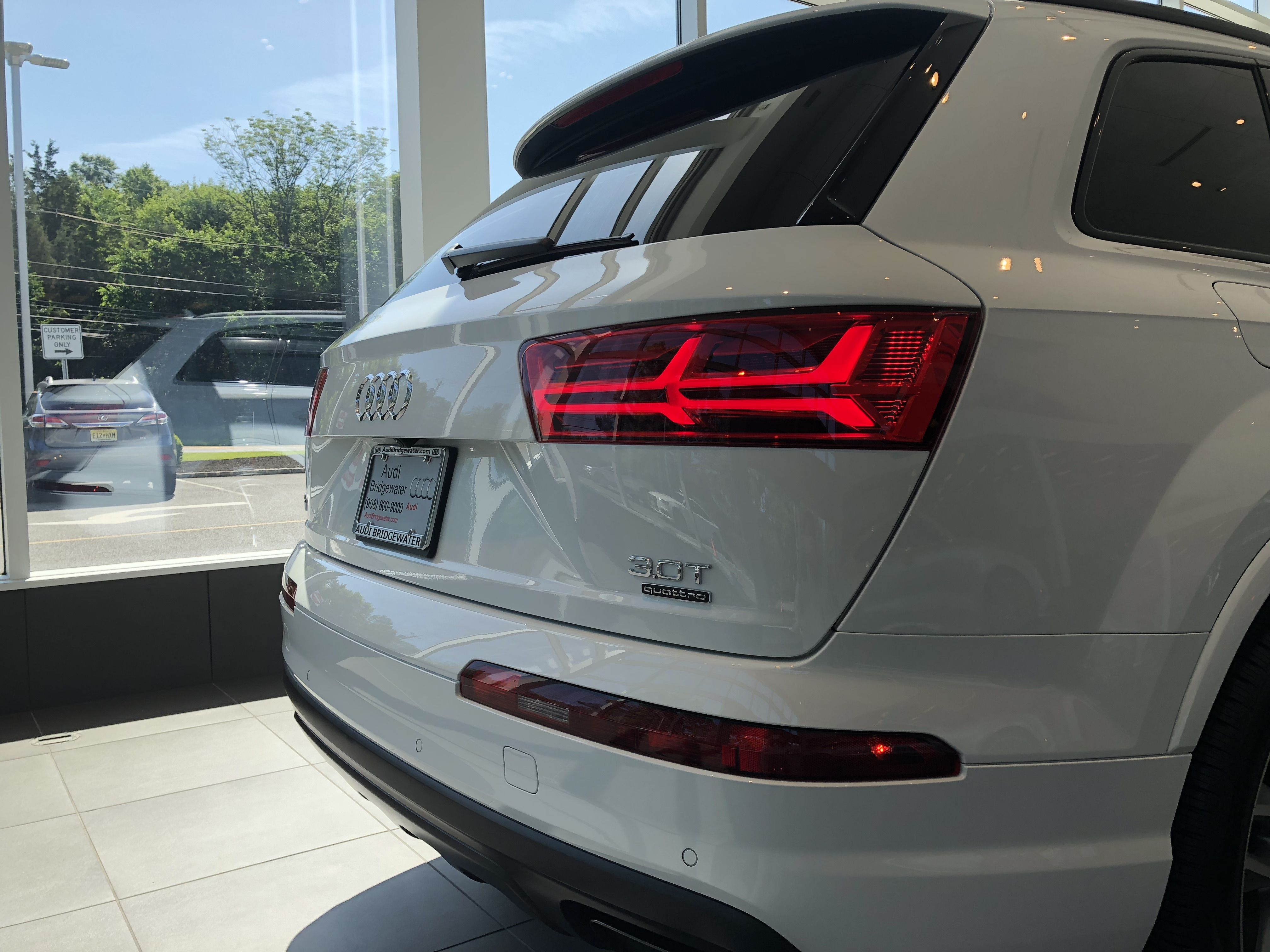 Angled View Of 2018 Audi Q7 With Tail Lights And Decals Vehicle Available At Audi Of Bridgewater Nj Audi Dealership Audi Audi Q7