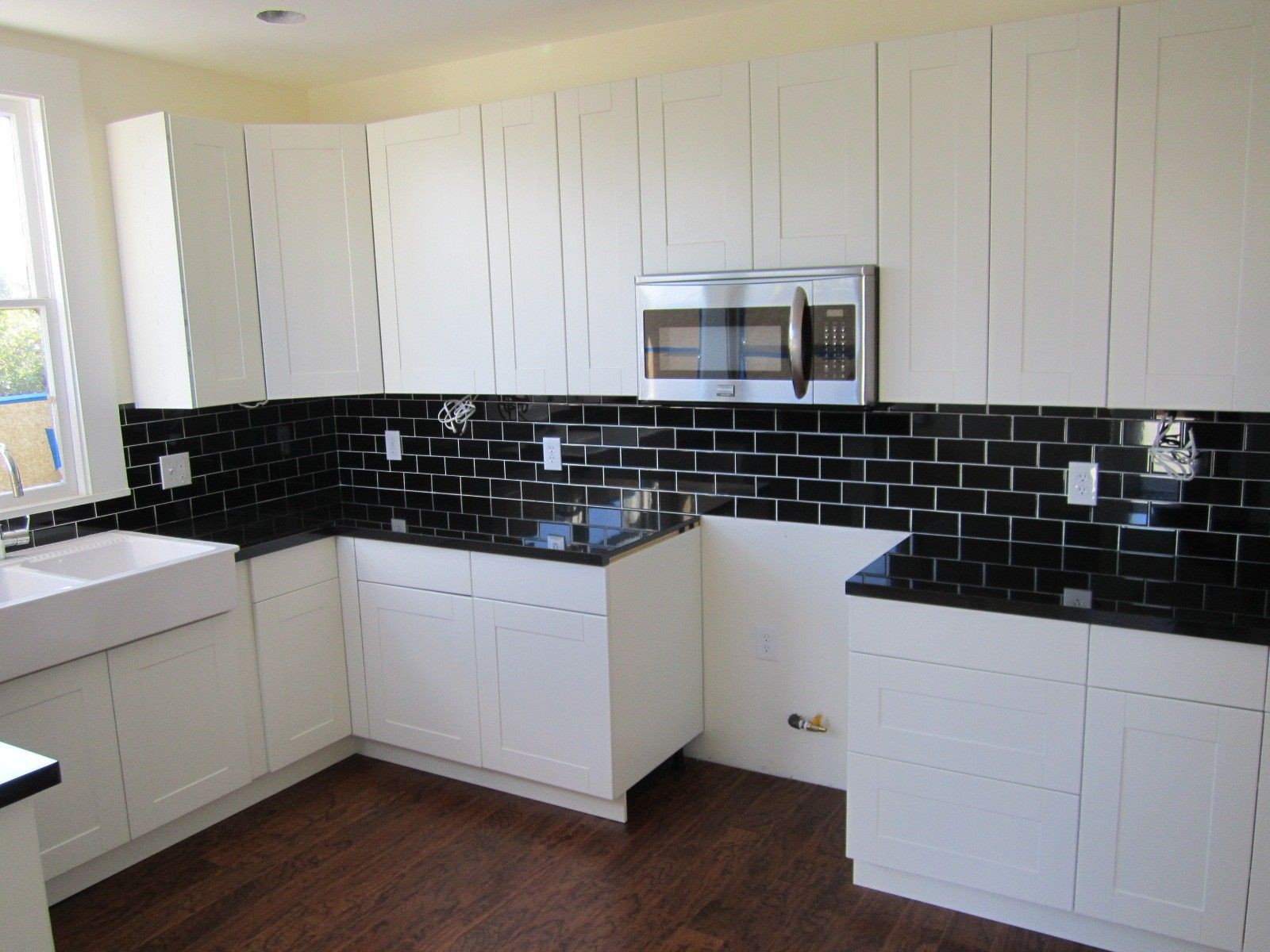 Black ceramic tile kitchen backsplash with white cabinet kitchen