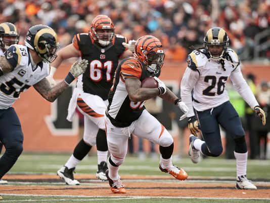 Bengals Walkthru: Turnt time for Jeremy Hill? Photo: Cincinnati Bengals running back Jeremy Hill (32) runs the ball across midfield in the second quarter of the NFL Week 12 game between the Cincinnati Bengals and the St. Louis Rams at Paul Brown Stadium in Cincinnati, on Sunday, Nov. 29, 2015. At the half, the Bengals led 17-7. The Enquirer/Sam Greene