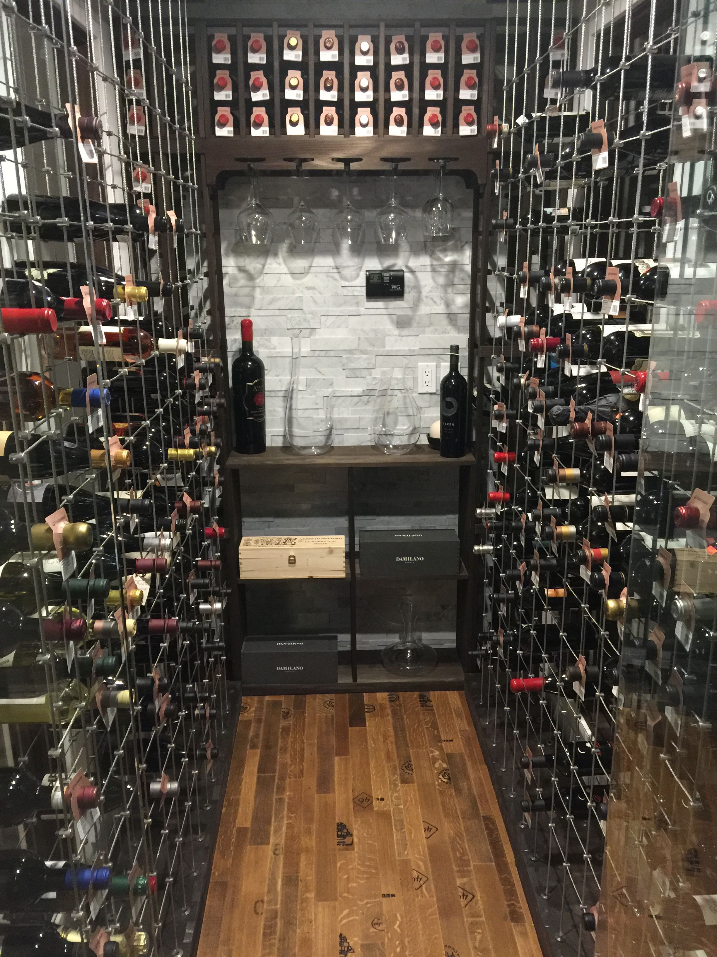 Wine Cellar Room With Glass Doors Wine Cellar With Cable Wine Racks Barrel Wood Floors And Carrara Stone Wall Wine Cellar Glass Door Stone Wall