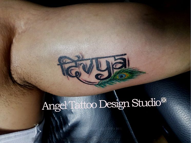 32e5d436ddc6e Divya name tattoo made on inner bicep at Gurgaon tattoo shop; call  8826602967 for appointment #Divya #Divyanametattoo #nametattooidea  #hinditattoo