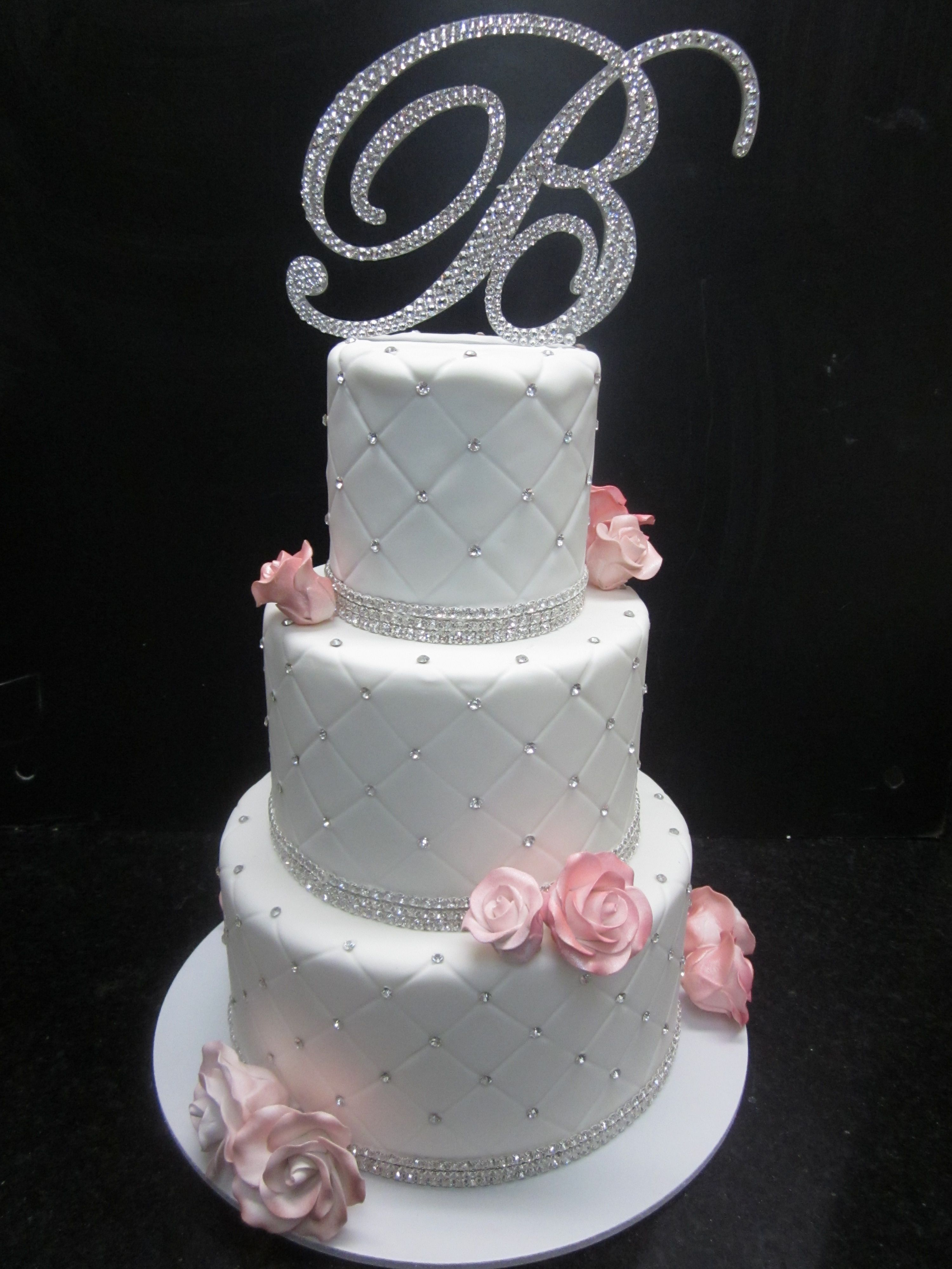 Quilted Wedding Cake With A Textured Look With Light Pink Sugar Roses On Each Layer Finished Wit Wedding Cake Quilted Wedding Cakes With Flowers Wedding Cakes
