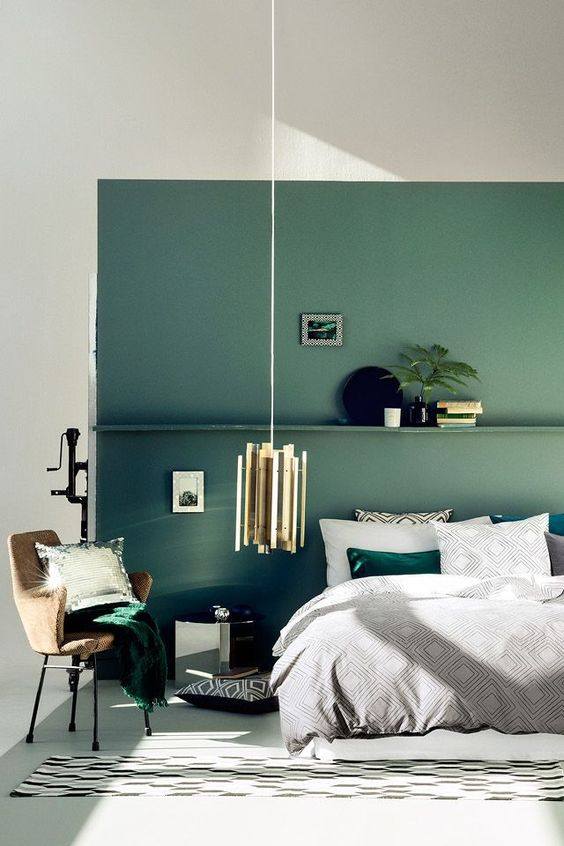 A Muted Green Accent Wall With A Shelf And Matching Emerald Bedding And A Pillow In 2020 Green Bedroom Walls Green Bedroom Design Green Accent Walls