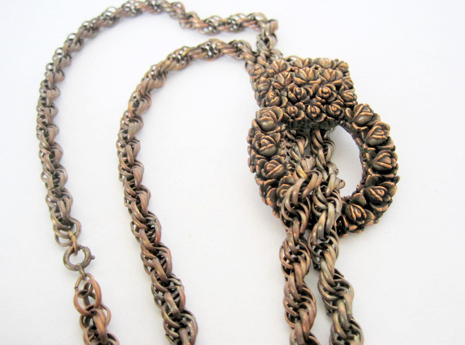 Lovely copper tassel necklace signed A Goodman NYC.  This  copper necklace was created by the compan