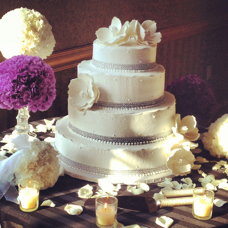 Ivory Four Tier Round Wedding Cake with single dots & Silver Rhinestone Ribbon.