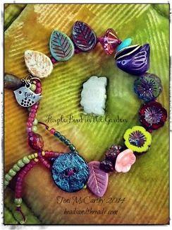 """""""PurpleBird in the Garden"""" Bracelet...hand-knotted on raspberry waxed linen, Czech glass, metal button."""
