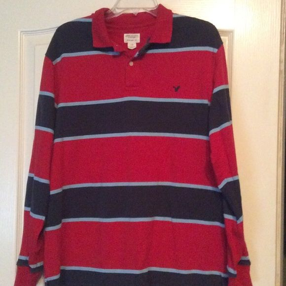 Striped Red Blue Long Sleeve Polo Shirt A preloved long sleeve shirt in red and blue stripes. Heavyweight material, so really warm and perfect for layering underneath. Could also fit XL. PET FREE SMOKE FREE HOME! American Eagle Outfitters Shirts Polos