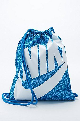 This drawstring gym bag by Nike is engineered from durable 300D ...