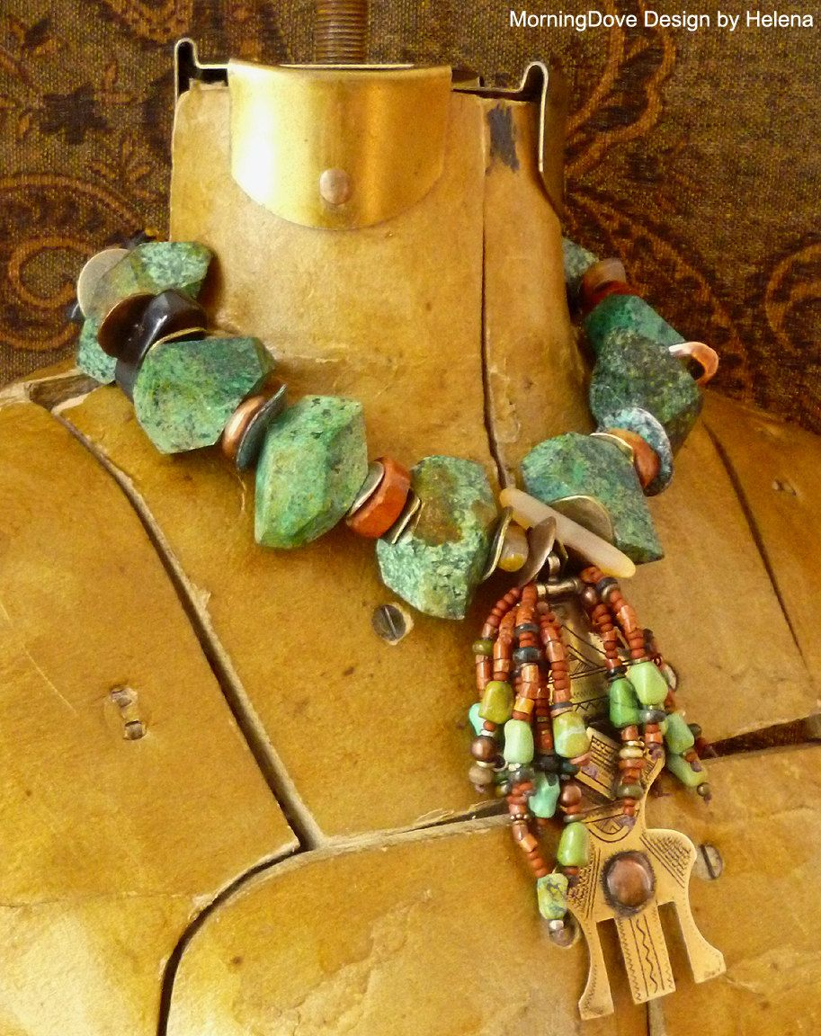 Necklace | Helena Nelson-Reed.  The pendant is a veil weight used by Tuareg women that has been combined with glass and natural stone hieshi, vintage turquoise, agates and mixed metals
