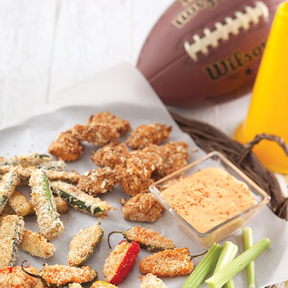 No game-day feastis complete without a selectionof burgers, dips, spreads, and something sweeter to keep you energized. Mix and match these recipes to create the ultimate menu of tailgating snacksfor your group of fans. Try fried food the light way with theseZucchini Fries with Tangy Horseradish DipandOven-Fried Pimiento Cheese-Stuffed