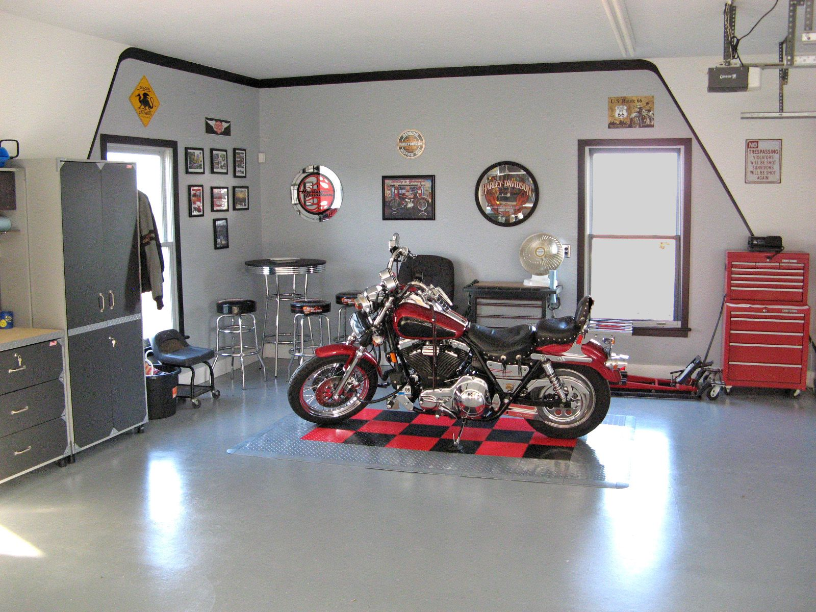 Harley color carpet tiles - Decoration After Remodel Inside Harley Davidson Garage Painted With Gray Wall And Floor Interior Color Decor Plus Small Round Table With Stools In