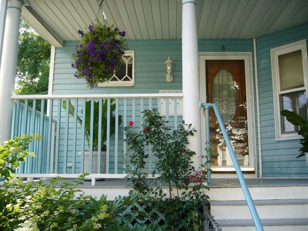 Robins Egg Blue Exterior With Red Front Door From Front Porch