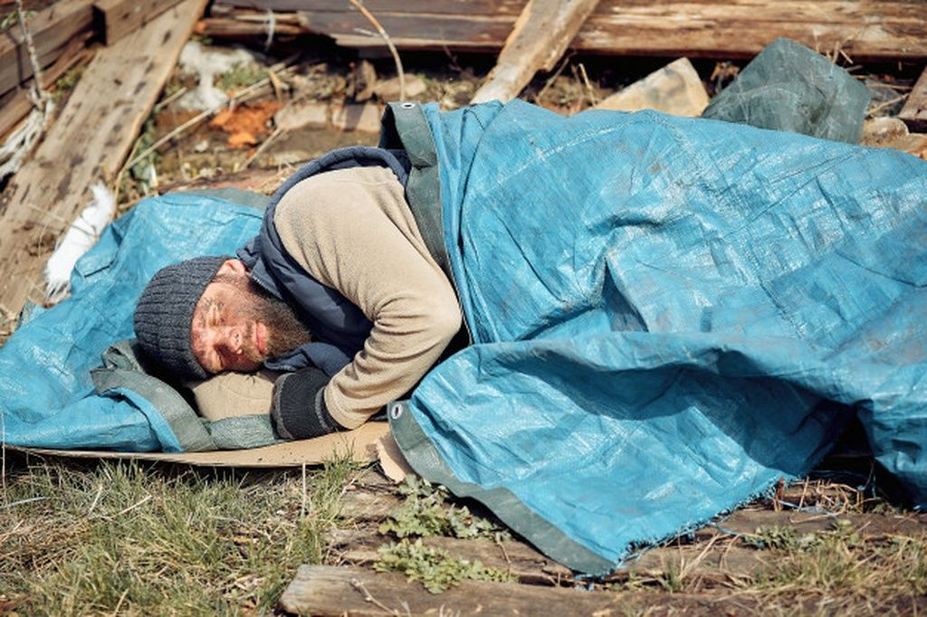 A Homeless Man Near The Ruins Sleeps On Cardboard Boxes Helping Poor And Hungry People During The Homeless Man Infographic Design Inspiration Outdoor Blanket