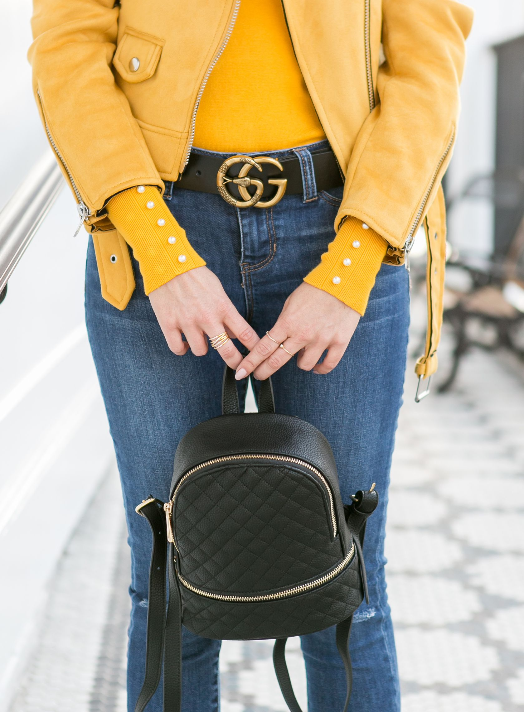22cb3fcf3d1 Sydne Style wears Gucci snake belt and backpack for fall fashion trends   yellow  denim  jeans  gucci  guccibelt