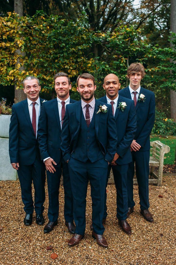 Rustic Wedding Groomsmen in three piece navy suits with maroon ...