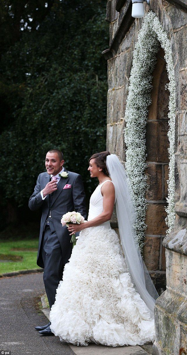 Flower power: The church doorway was outlined with beautiful white flowers
