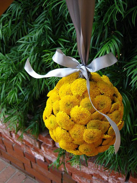 For the flower girl wedding african american brides and weddings the flower girl will carry a small yellow button pomander ball hanging from charcoal gray mightylinksfo
