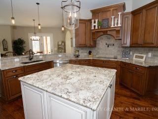 Best Alaska White Granite Kitchen Island With White Cabinets In 400 x 300