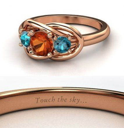 Disney inspired engagement rings the picture shows the Merida ring