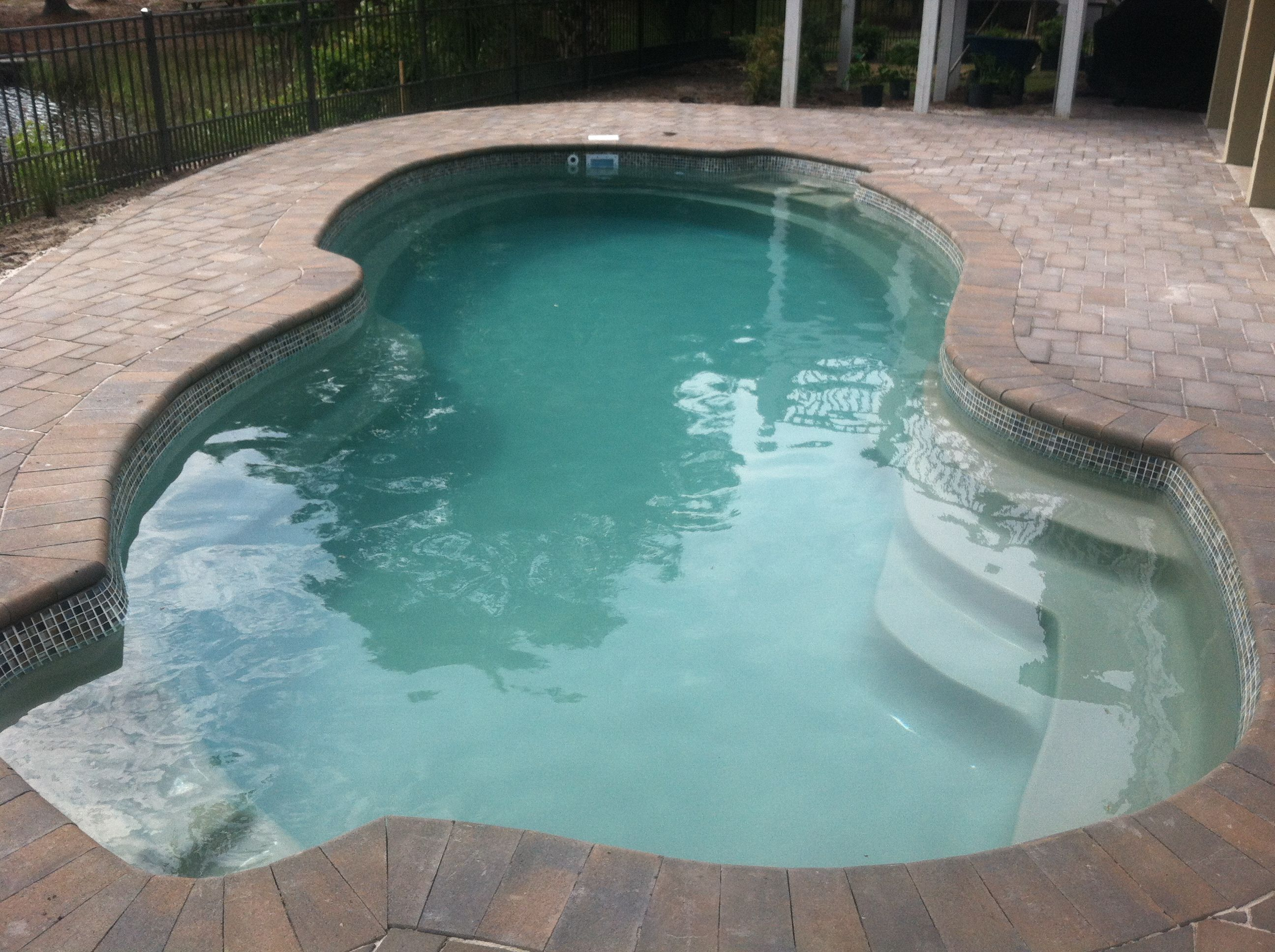 a close up shot of a topaz baron pool great seating in this
