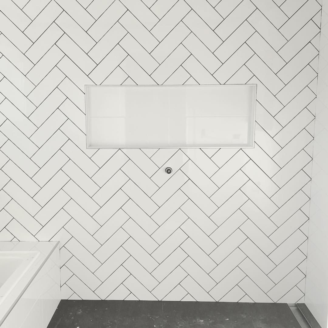Main bathroom - herringbone tiles with dark grout ✓ Sapphire ...