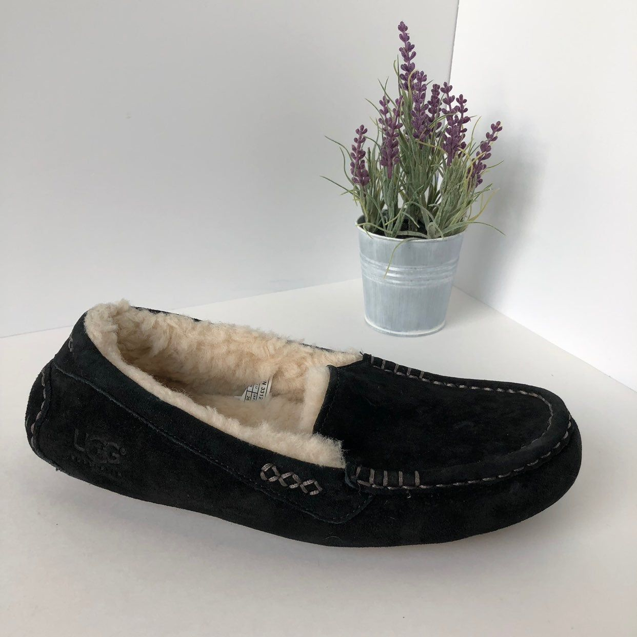 Black UGG slip ons with plush material