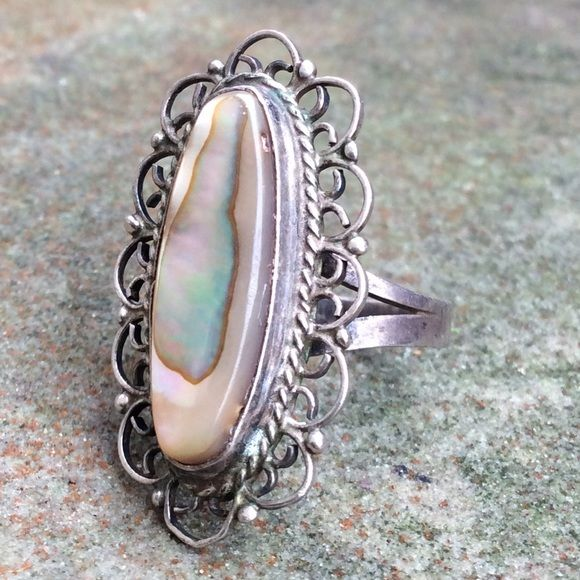 Vintage TAXCO Sterling silver abalone ring Vintage 70's Sterling silver TAXCO abalone shell ring- made in Mexico. Stamped with TAXCO eagle, and has artists initials and 925. Very beautiful and delicate filigree oval surrounding the abalone shell. Size 6.5/6.75 on mandrel. Make sure to check out my other vintage Sterling jewelry and bundle for a discount! Vintage Jewelry Rings