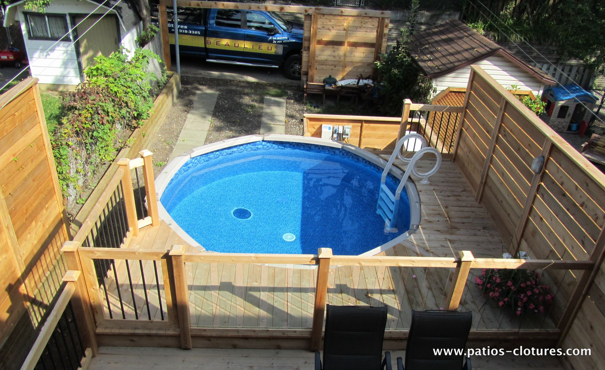 Aboveground pool deck with tempered glass railing, a