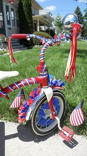 I decided to decorate the girls bikes for the 4th of July. I figured they could ride their bikes to the parade. Where we live, we can walk...