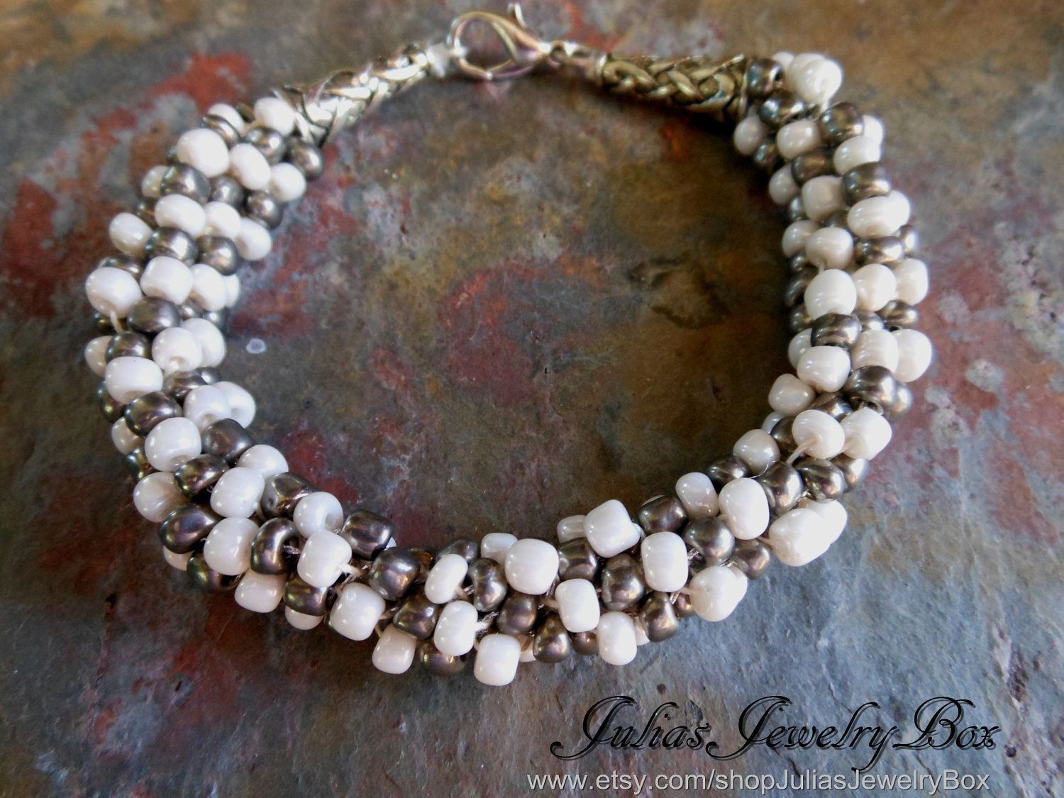 Kumihimo Bracelet, Pearl and Grey beads, Braided, Lobster Clasp, Pink/Cream and Gunmetal. $25.00, via Etsy.